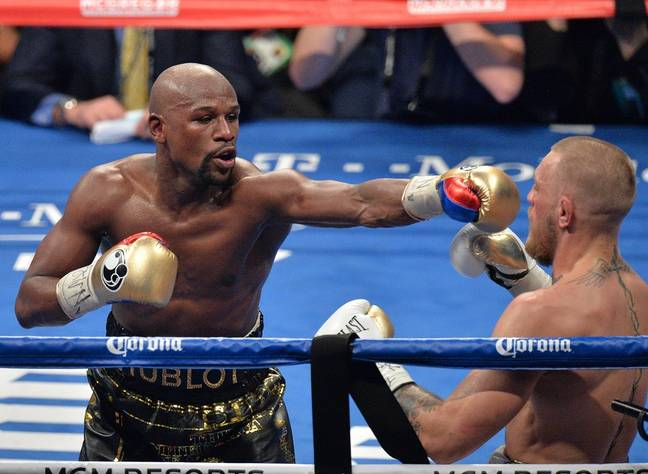 Mayweather takes on McGregor last year. Credit: PA