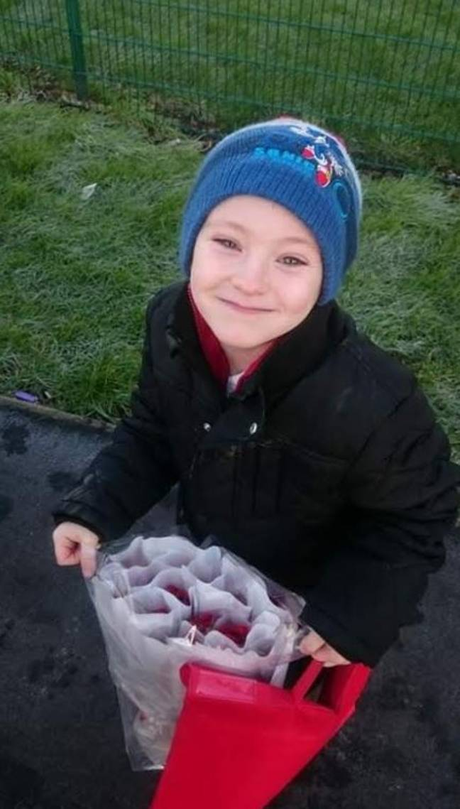 Callum with his roses to take to school. Credit: Lincolnshire Live/BPM MEDIA
