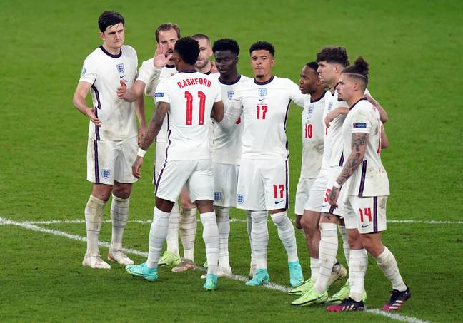 Rashford is consoled by his teammates. Credit: PA