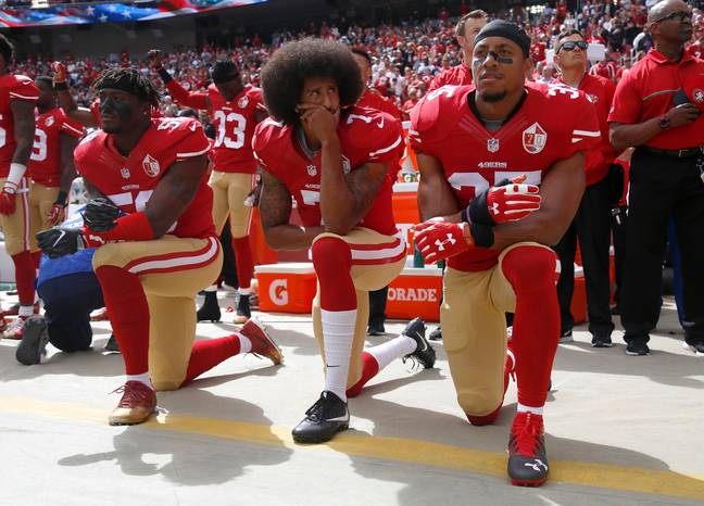 Colin Kaepernick and his teammates kneels in protest before an NFL game. Credit: PA