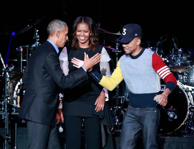 Barack and Michelle Obama with Chance the Rapper. Credit: PA