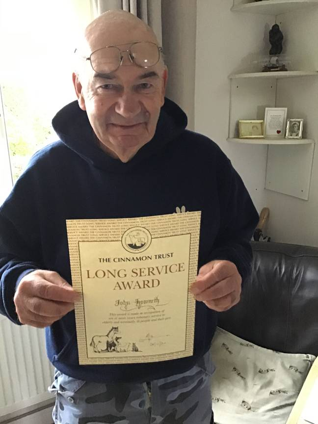 John received a long service award from The Cinnamon Trust. Credit: Ginny Howarth