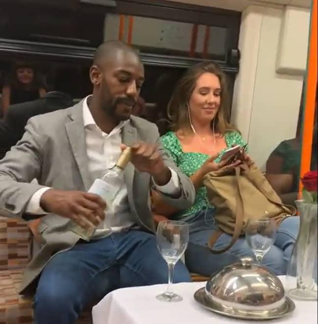Elvin Mensah served up a romantic dinner for one unsuspecting commuter. Credit: Instagram/elvinmensah
