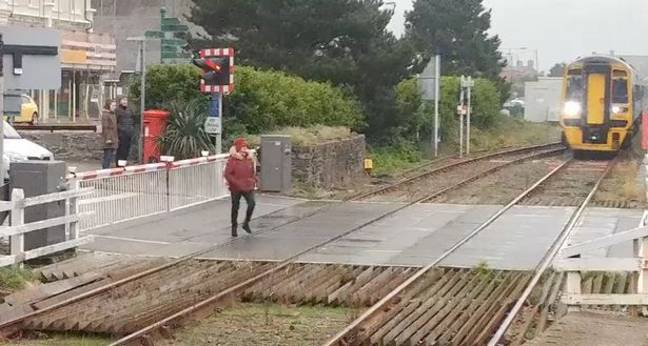 The woman crossed the tracks ignoring any warning. Credit: Wales Online