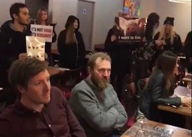 Most diners appear to be unaffected by the vegan rally in Touro Steakhouse in Brighton. Credit: Triangle News