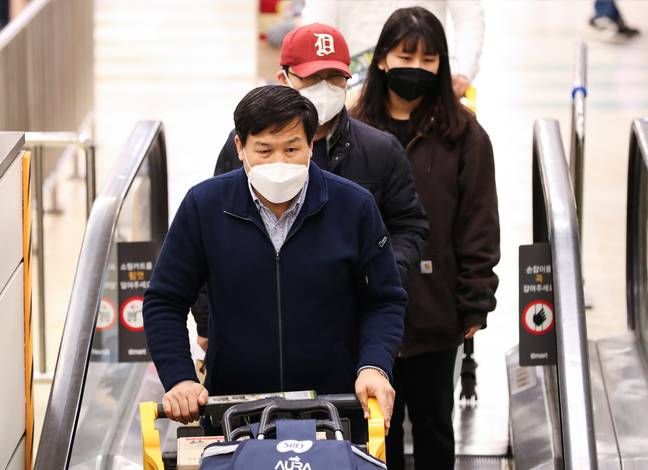 Shoppers wearing masks in Seoul, South Korea. Credit: PA