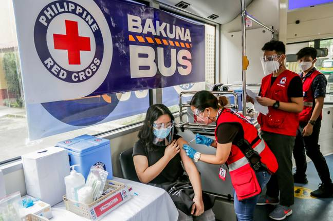 A woman being vaccinated in Manila, the Philippines. Credit: PA