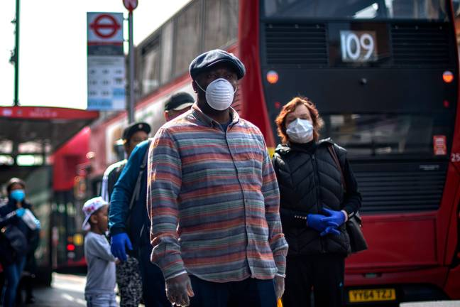 People wearing face masks in London. Credit: PA
