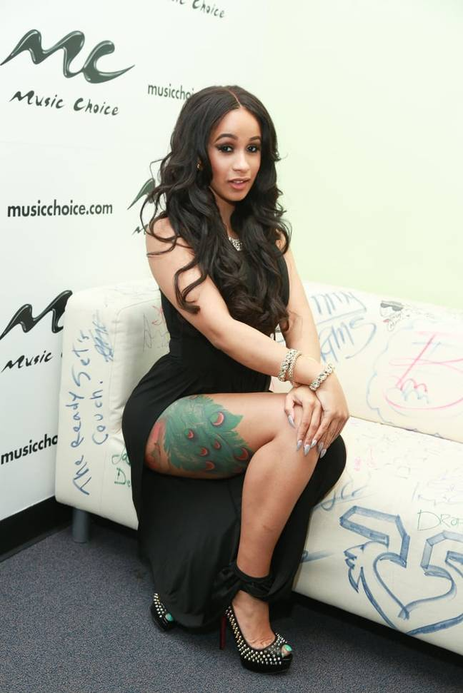 Cardi B has a peacock tattooed on her waist and leg Credit: Getty