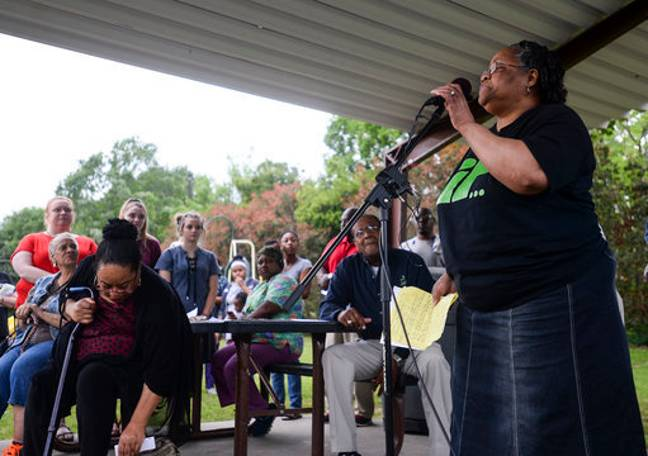 Betty Boatner, a sister of James Byrd Jr., talks to the crowd during a prayer vigil at James Byrd Memorial Park in Jasper, Texas, yesterday. Credit: PA