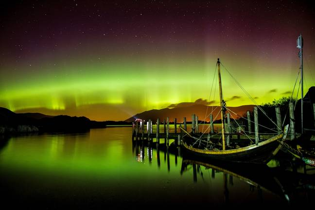 The Northern Lights can be seen at many places in the world - including in the Lake District, England. Credit: PA