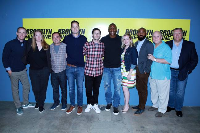 Dan Goor and the B99 cast. Credit: PA