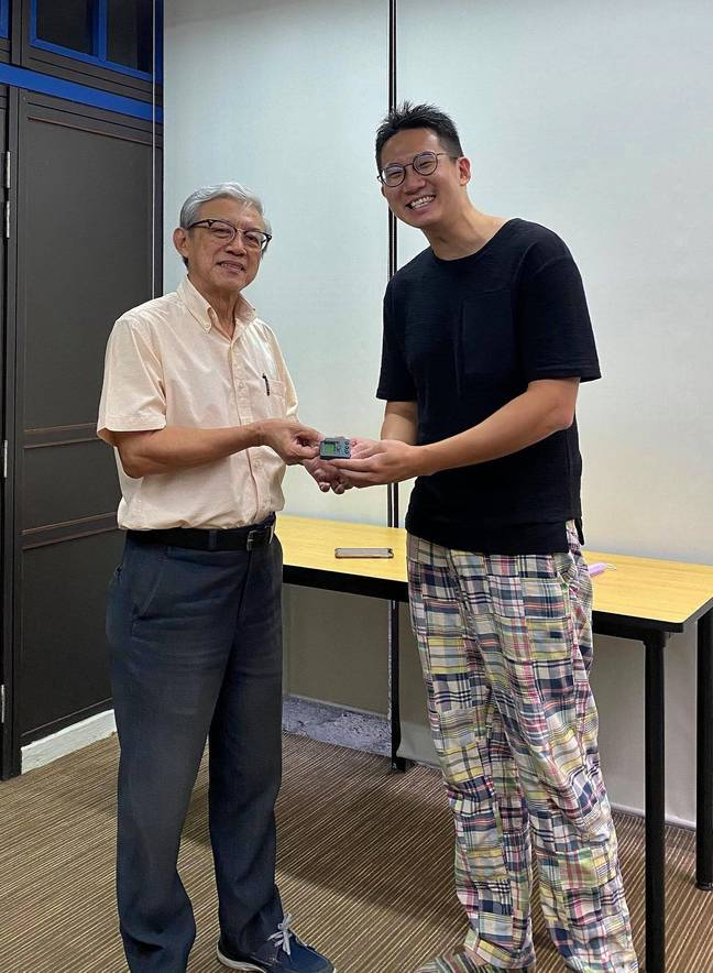 The pair reunited so Mr Lim could return the device. Credit: Newsflash