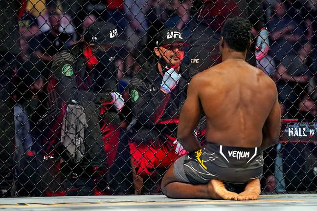Uriah Hall reacts after Weidman's horrific injury. Credit: PA
