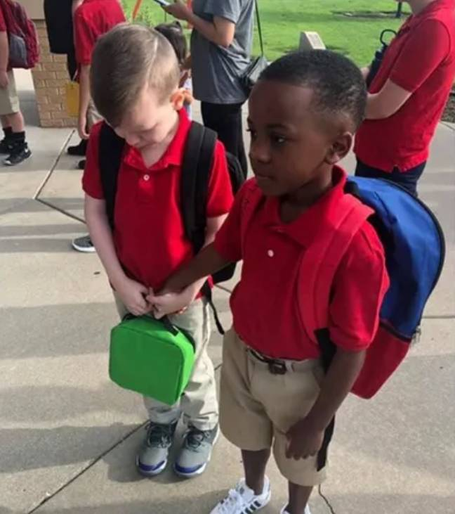 Christian saw Connor crying on their first day of school and rushed over to hold his hand. Credit: Courtney Moore