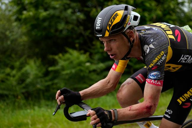 German cyclist Tony Martin rides with injuries to his arm after the incident. Credit: PA