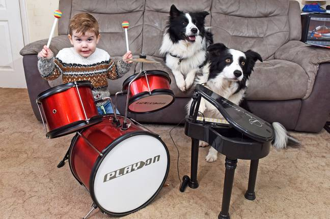 Jenson playng the drums for Fenn and Nova. Credit: Caters