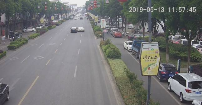 The white Ferrari can be seen swerving into the middle lane, crashing into another car. Credit: AsiaWire
