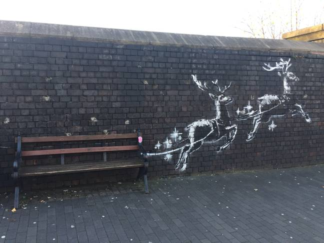 Banksy's new Christmas-themed mural. Credit: PA
