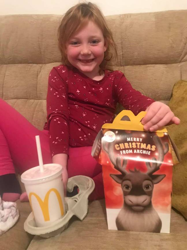 Chloe is clearly delighted with her Happy Meal. Credit: Deadline News