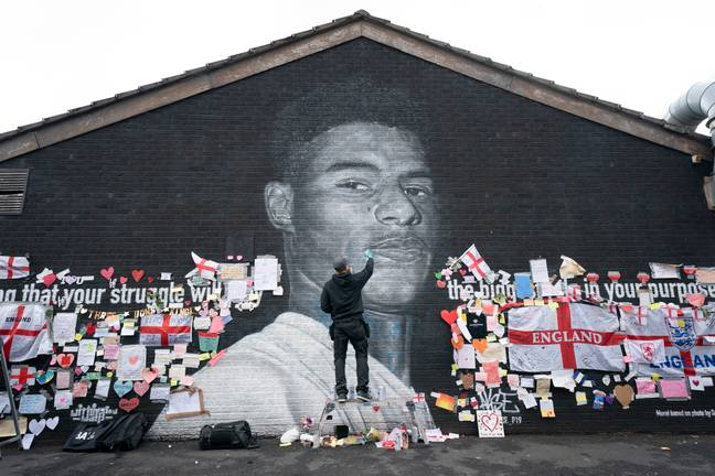 The mural of Marcus Rashford in Withington has now been flooded with messages of support. Credit: PA