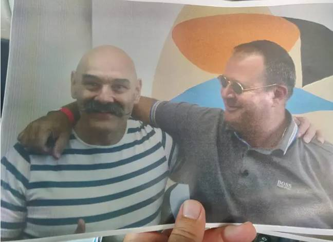 Bronson pictured in prison with his son George Bamby. Credit: George Bamby