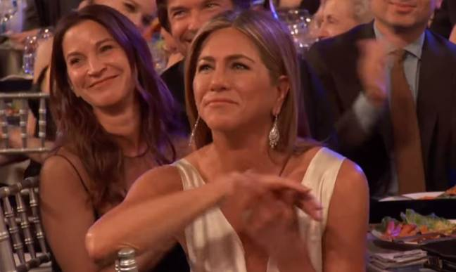 Jennifer Aniston clapped at Brad's joke. Credit: TNT