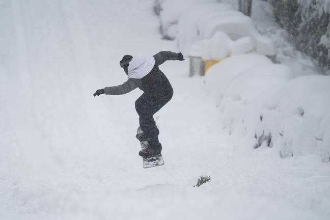 A man riding a snowboard in Madrid on Saturday (9 January). Credit: PA