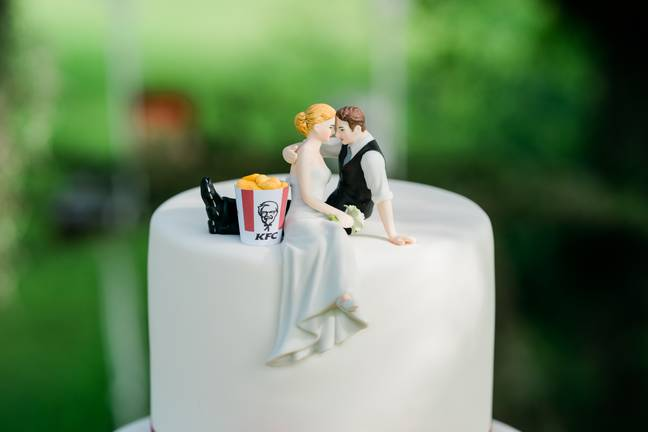 The couple's KFC-themed wedding cake. Credit: KFC