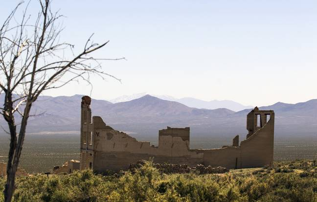 Ruins of stone foundations remain in the ghost town of Rhyolite. Credit: PA