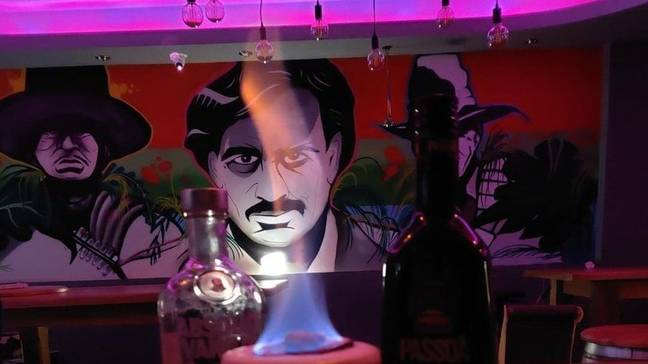 There is a mural inside the bar which appears to depict the drug lord. Credit: Escobar