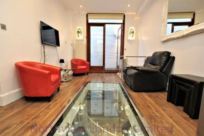 An upstairs living room looks down onto the pool. Credit: Zoopla