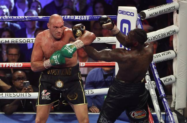 Fury and Wilder last February. Credit: PA