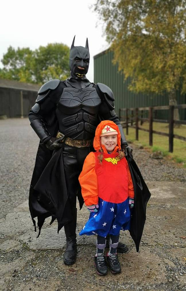 Carmela was greeted by Batman at the finish line. Credit: Muscular Dystrophy UK