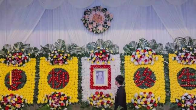 Xu Shinan at the funeral of his  fiancée Yang Liu. Credit: AsiaWire