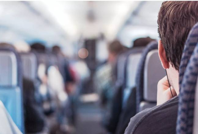 Why should this aisle seat bastard get to use a middle armrest? Credit: Gratisography/Pexels