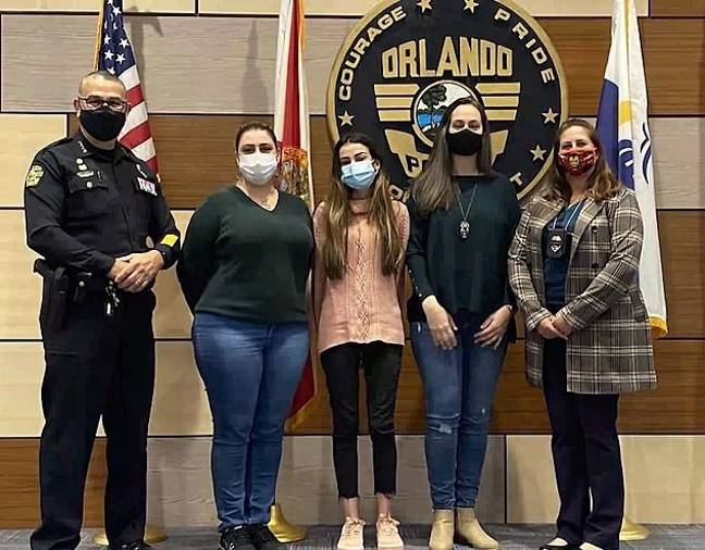 Flaviane Carvalho (second right). Credit: Orlando Police Department