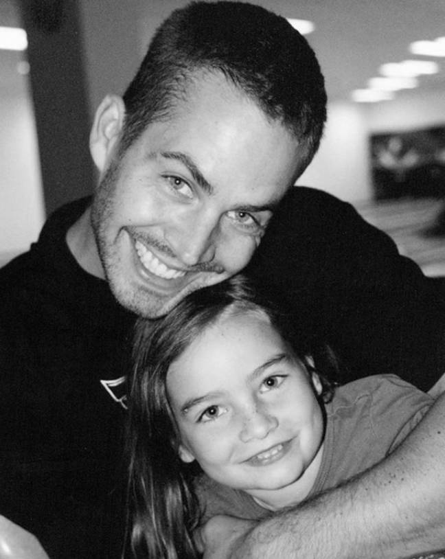 A throwback snap of Meadow with late father Paul. Credit: Instagram/Meadow Walker