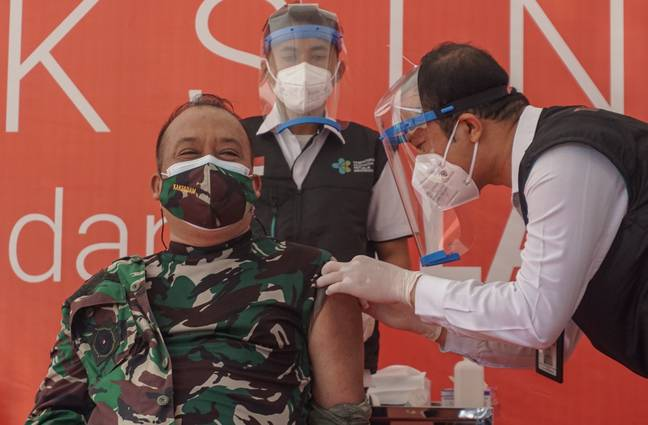 Bali province government top officials are injected with the Sinovac vaccine. Credit: PA