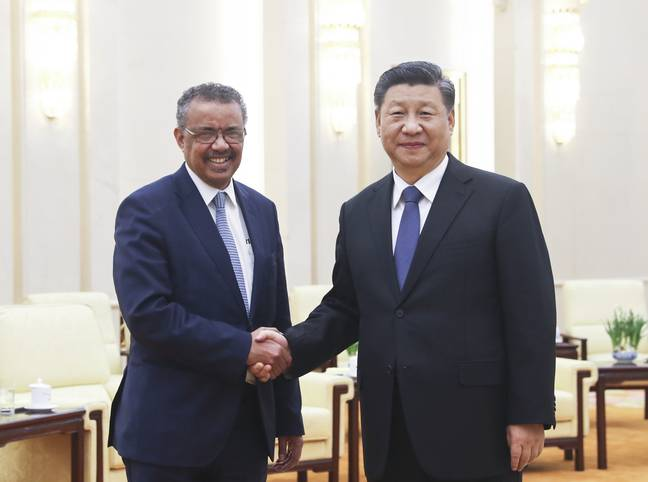 WHO Chief Tedros Adhanom Ghebreyesus with Chinese President Xi Jinping. Credit: PA