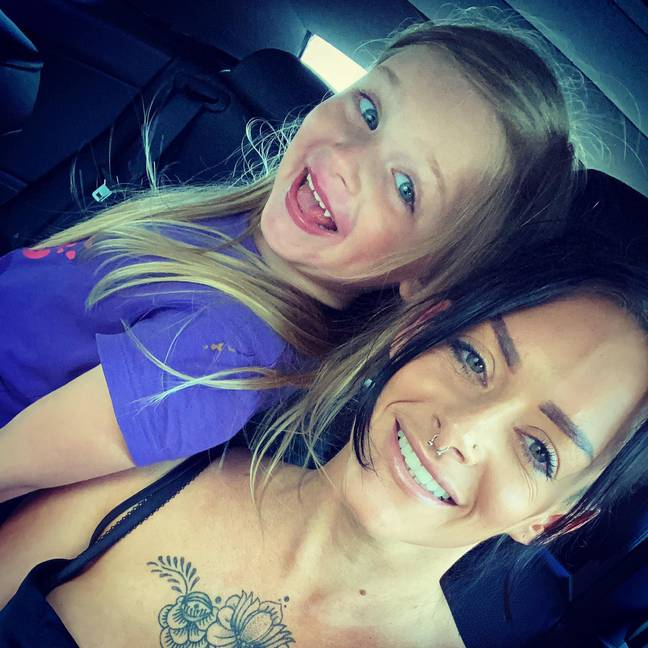 Lucy Mitchell with one of her children. Credit: PA Real Life