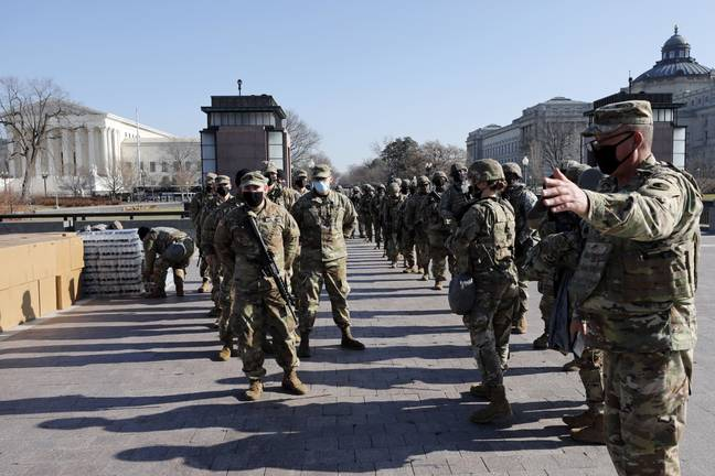 Members of the National Guard arrive on Capitol Hill during the Impeachment debate. Credit: PA