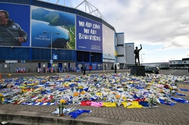 Floral tributes dedicated to missing footballer Emiliano Sala outside the Cardiff City Stadium. Credit: PA