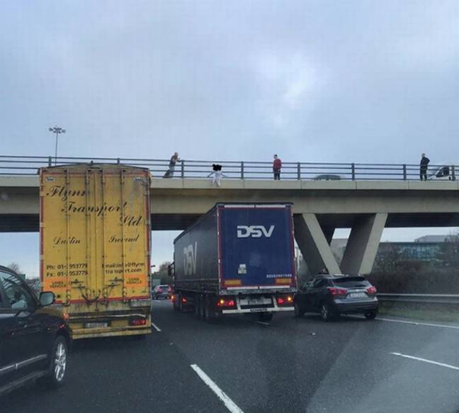 A lorry driver has been hailed a 'hero' for stopping under a motorway bridge as a girl sat on the edge. Credit: Keith Dunne