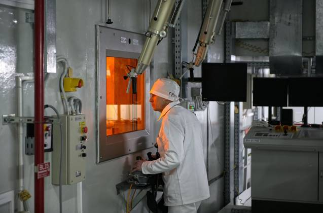 Staff working in a facility dealing with radioactive waste from the plant