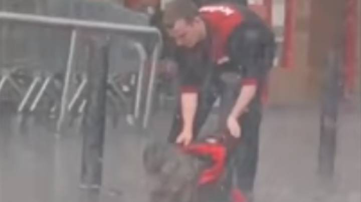 Iceland Employees Give Coat To Dog Caught In Torrential Rain Outside Store