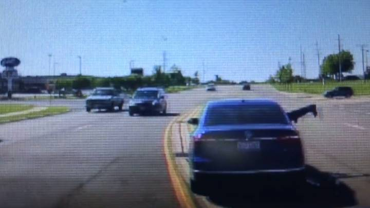 Man Heroically Jumps Headfirst Into Moving Car To Save Driver Having A Seizure