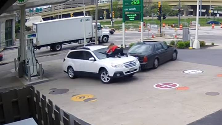 Woman Jumps On Her Car To Stop Thief From Driving Off