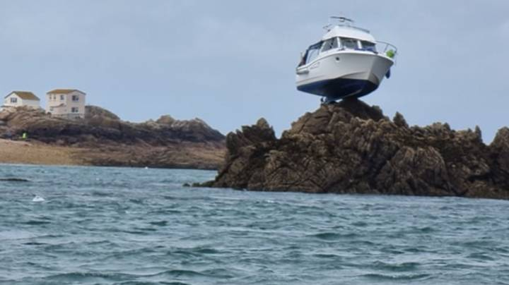 Boat Marooned 10 Feet In Air After Getting Stuck On Rocks