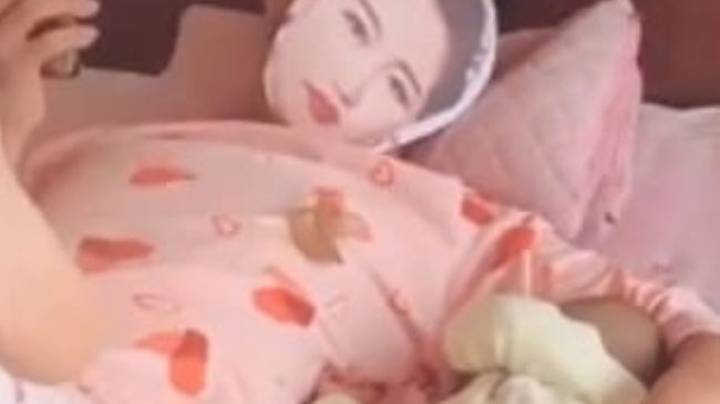 Dad Wears Mask Of Wife's Face And Her Pyjamas To Stop Their Baby Crying